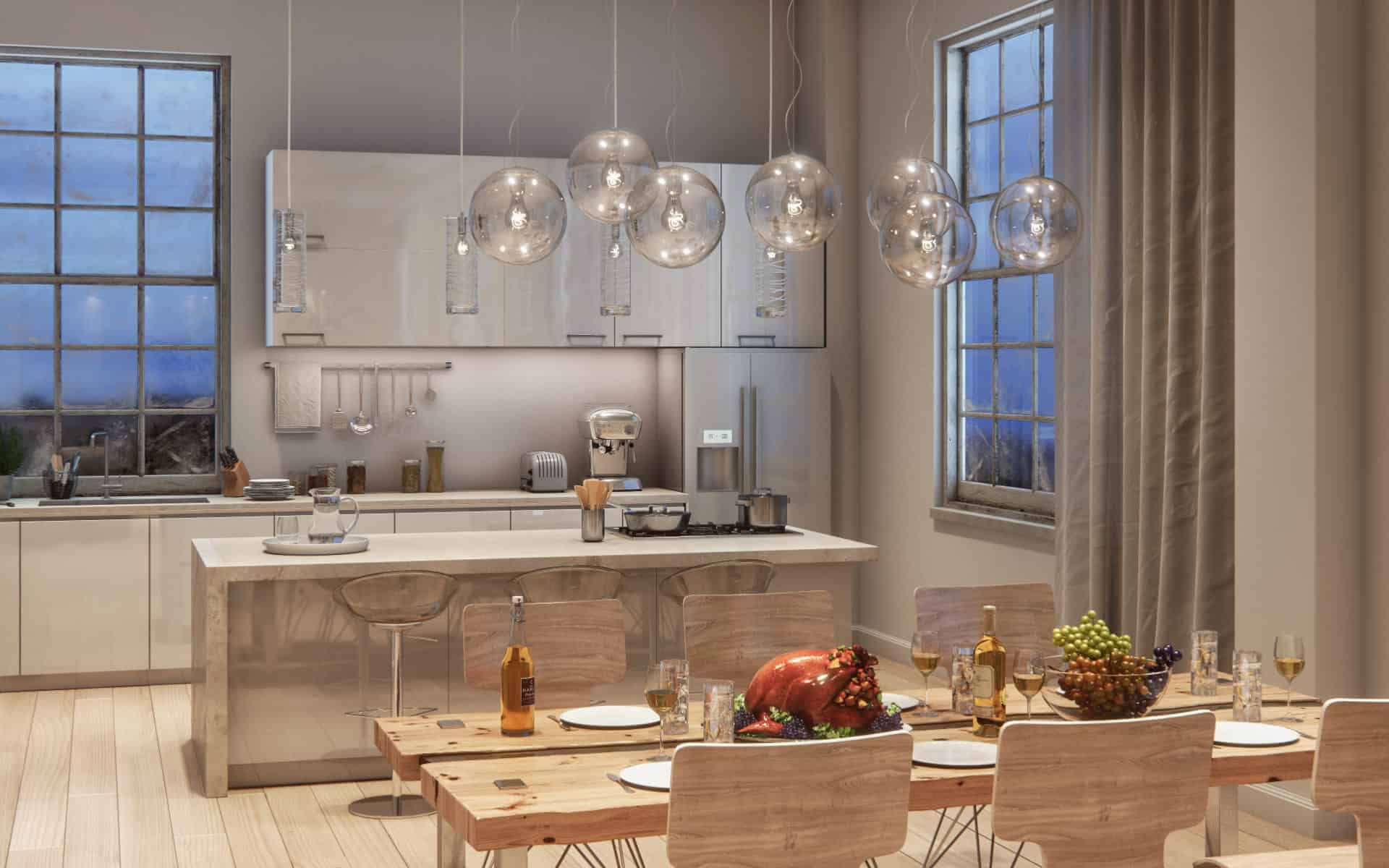 This modern loft kitchen features different wood tones and patterns and marble top kitchen island.
