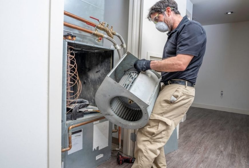 HVAC contractor fixing furnace