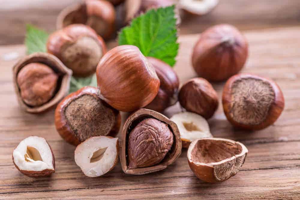 Hazelnuts on a cutting board