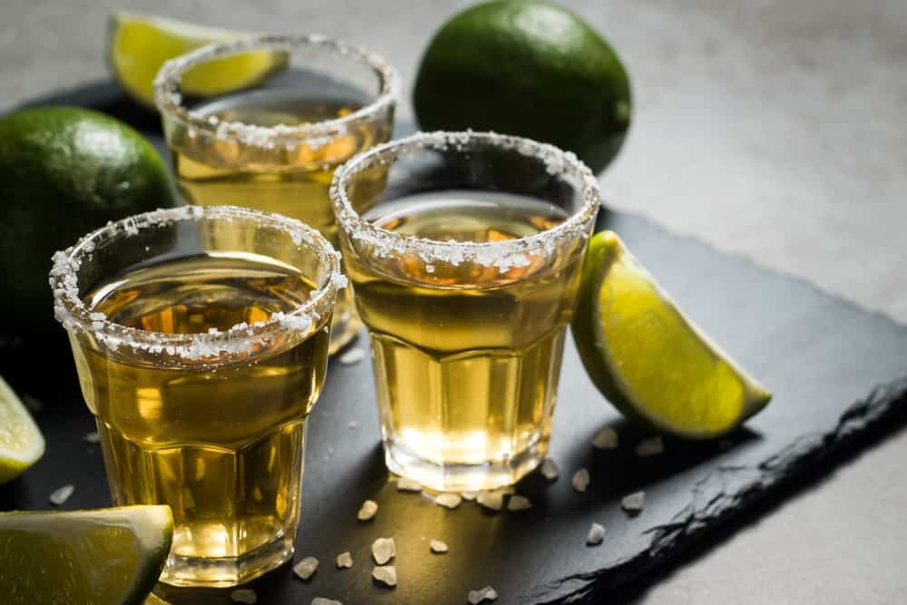 Shots of gold Tequila.