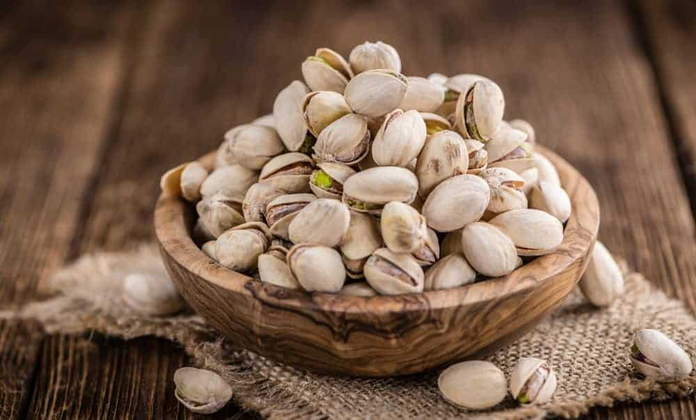 Bowl of pistachio nuts in the shell