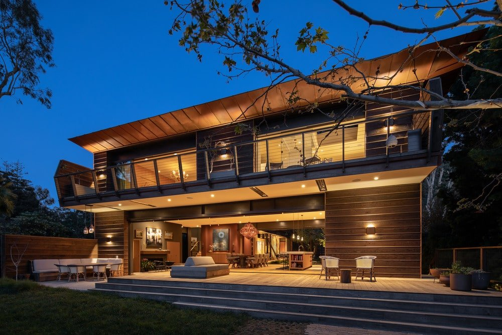 Rear exterior view of this contemporary house boasting its stunning architectural style.