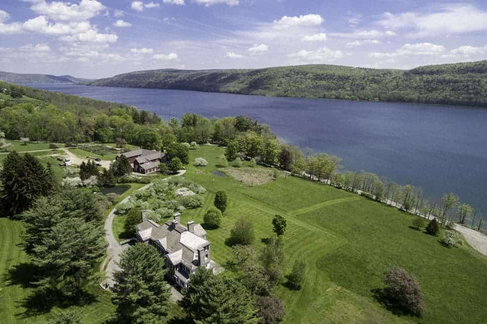 This aerial view of the property shows the massive lawn of the house before it reaches the lake. Images courtesy of Toptenrealestatedeals.com.