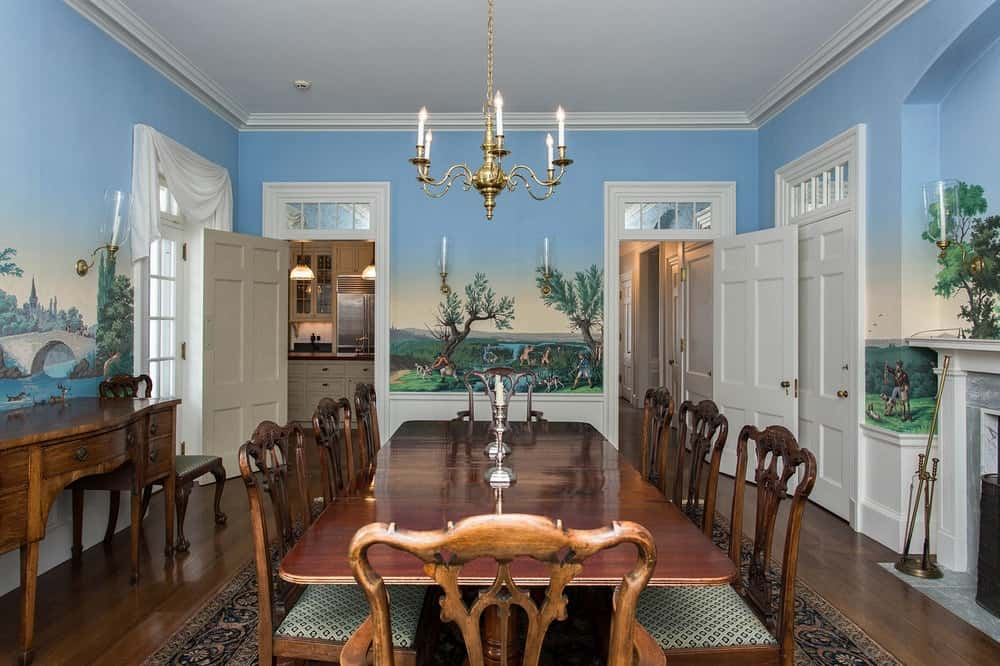 This is a closer look at the large wooden dining table of the dining room surrounded by gorgeous wooden chairs and topped with a simple chandelier hanging from the white ceiling. Images courtesy of Toptenrealestatedeals.com.