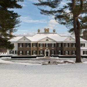 This is the gorgeous front view of the Farmlands mansion with a distinct Federal-style that gives it a classic elegance complemented by the beautiful snowy scenery with tall trees. Images courtesy of Toptenrealestatedeals.com.