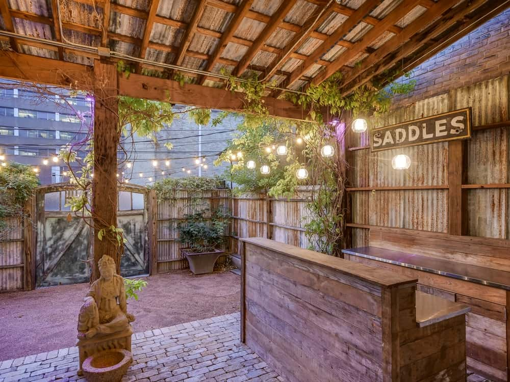 At the corner of the back is a covered area fitted with wooden structures that can be used as an outdoor cooking area or even a bar for occasions. Images courtesy of Toptenrealestatedeals.com.