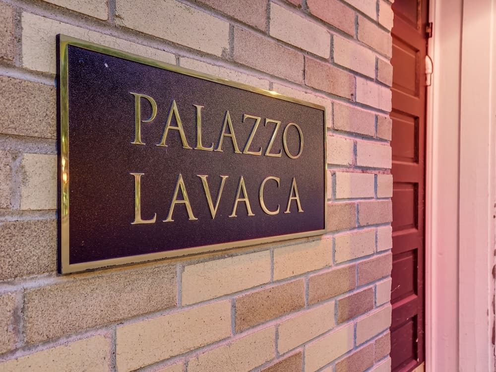 This is a closer look at the plate mounted by the main entrance depicting the name of the estate, Palazzo Lavaca. Images courtesy of Toptenrealestatedeals.com.
