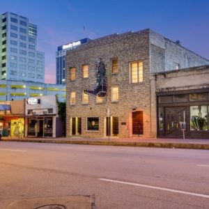 The classic look of the historic building gives it a unique look at this day and age and the rustic logo of the boot company retained on the house's facade gives it an additional charm. Images courtesy of Toptenrealestatedeals.com.