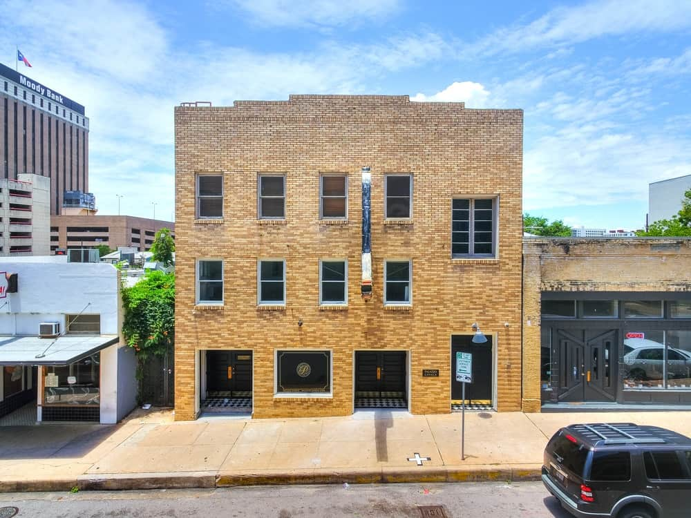 The historic building has an Old Western look with its shape and design that are updated by the modern windows and doors. Images courtesy of Toptenrealestatedeals.com.