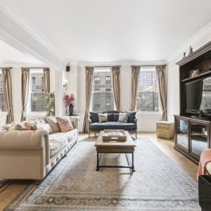 This is a gorgeous great room that houses the living room and the dining area under one large white ceiling that is illuminated by the row of floor-to-ceiling-windows on the far side of the great room. Images courtesy of Toptenrealestatedeals.com.