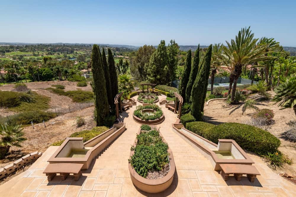 Here's the home's courtyard with stunning landscaping design and greenery. Images courtesy of Toptenrealestatedeals.com.