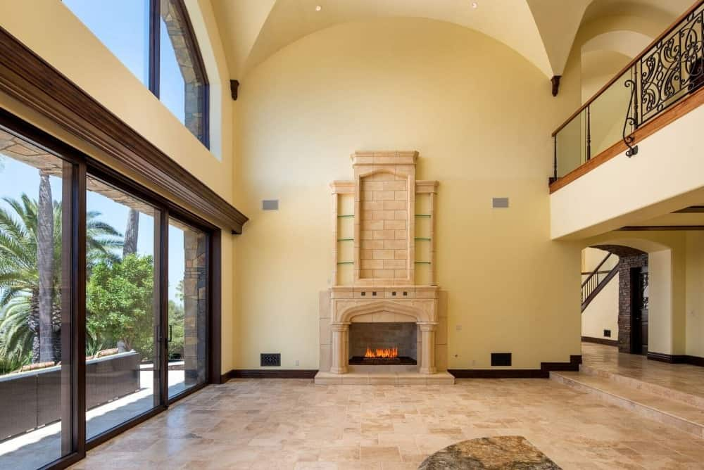 Another look at the home's great room facing the living space area with a gorgeous fireplace. Images courtesy of Toptenrealestatedeals.com.
