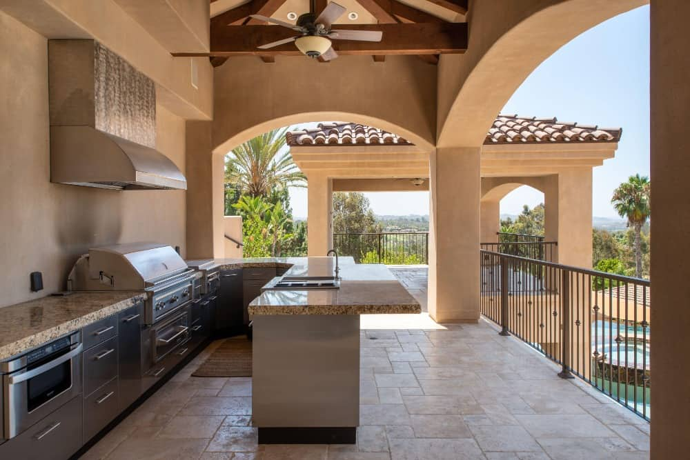 Outdoor kitchen set on the balcony overlooking the home's wonderful backyard. Images courtesy of Toptenrealestatedeals.com.
