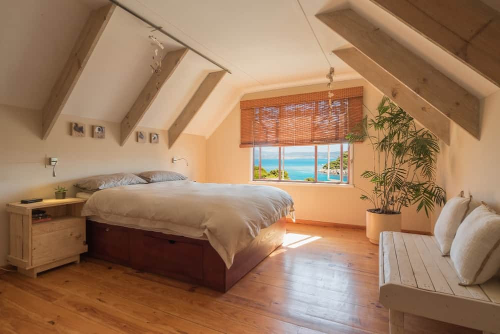 A beautiful guest bedroom with beige walls and ceiling.