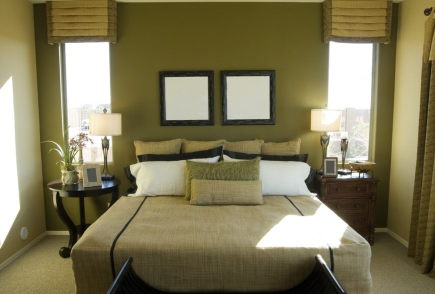 A charming guest bedroom with green walls and sheets.