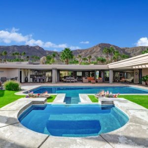 This is the sweeping view of the house from the vantage point of the pool and spa. Here you can see that the walls of the sections of the house has open walls due to the folding glass walls. You can also see here the amazing views of the mountains in the distance serving as a breathtaking background for the beige exteriors of the house. Images courtesy of Toptenrealestatedeals.com.