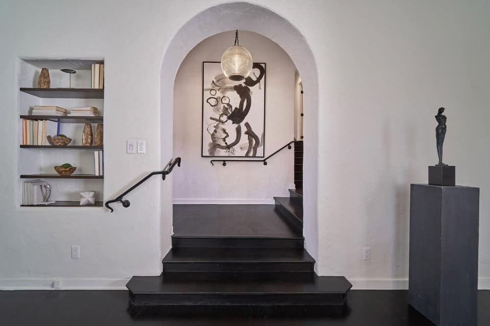 This black and white entry hall of the house highlighting coffee completed hardwood deck and white walls.