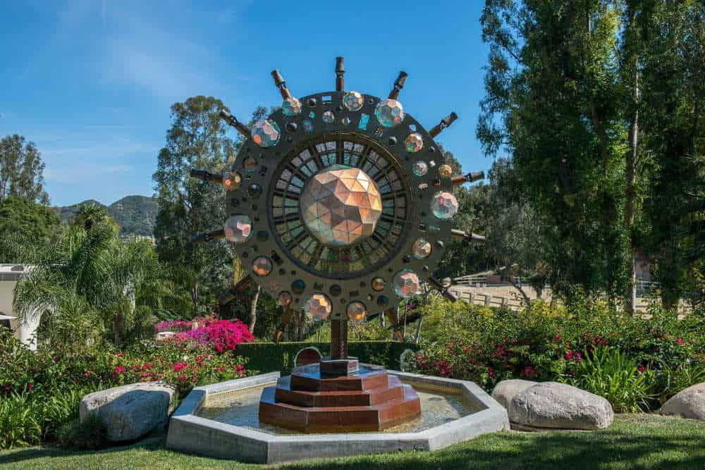 The garden of the grounds is adorned with this unique and decorative fountain that looks like a sun. Images courtesy of Toptenrealestatedeals.com.