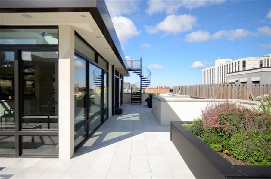 This is the wrap-around balcony complemented by the gorgeous glass walls of the house exterior and the planters on the sides with colorful shrubs. Images courtesy of Toptenrealestatedeals.com.