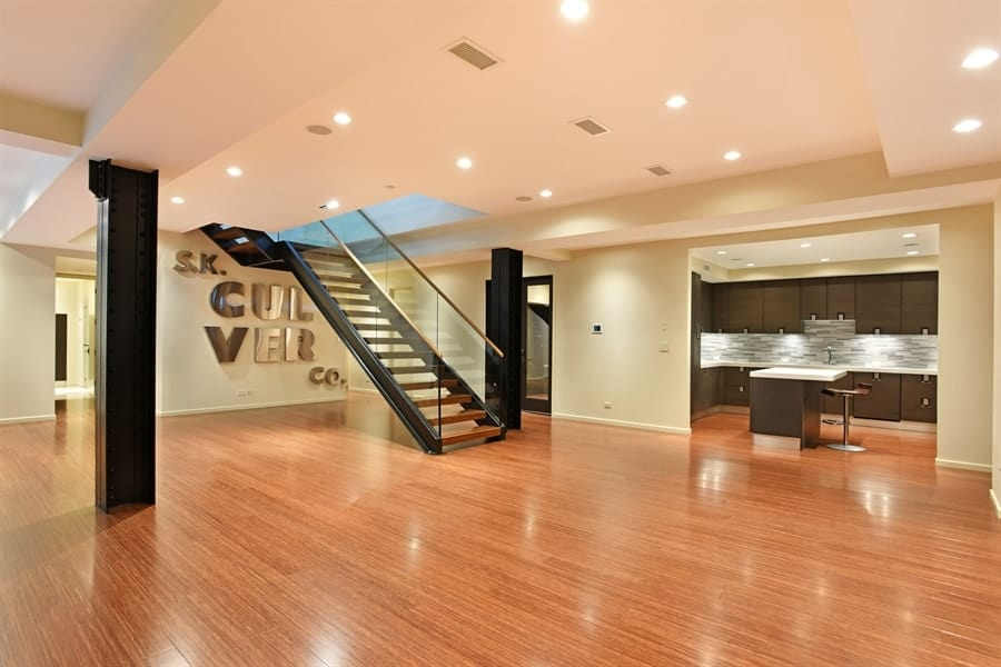 This wide hall has a big open space that can be used for any occasion to admit a large number of guests. The warm lights complement the beige walls contrasted by the dark steel frame of the staircase. Images courtesy of Toptenrealestatedeals.com.