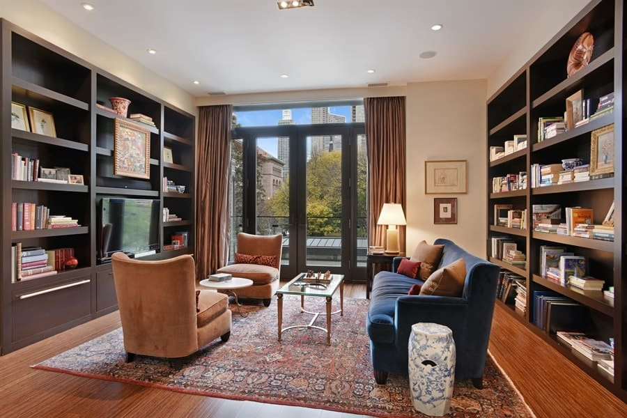 The simple yet gorgeous library of the house has a couple of large wooden bookshelves embedded into the walls flanking the comfortable blue velvet sofa and the two brown cushioned chairs. Images courtesy of Toptenrealestatedeals.com.