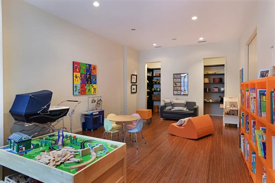 This is the beautiful playroom of the house with a wide and open hardwood flooring with enough space for play, a couple of sofas for sitting and even a table and chair set. Images courtesy of Toptenrealestatedeals.com.