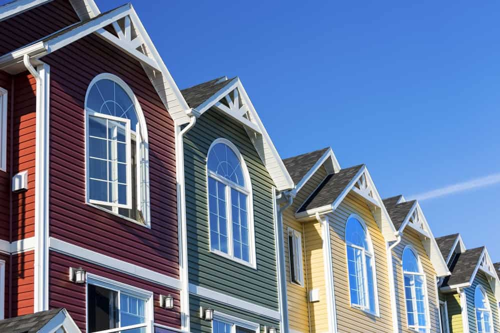 A row of differently-colored townhouses.