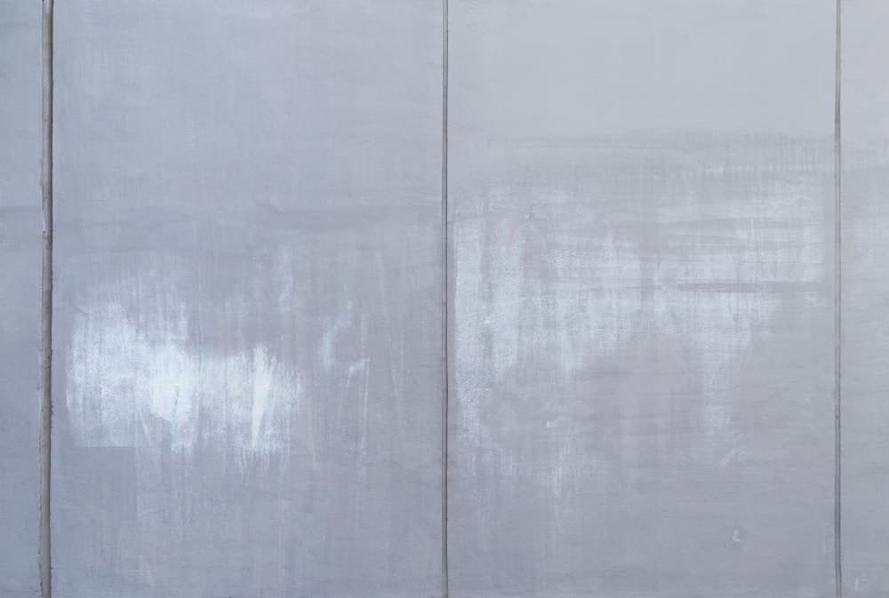 Glossy concrete wall surface.