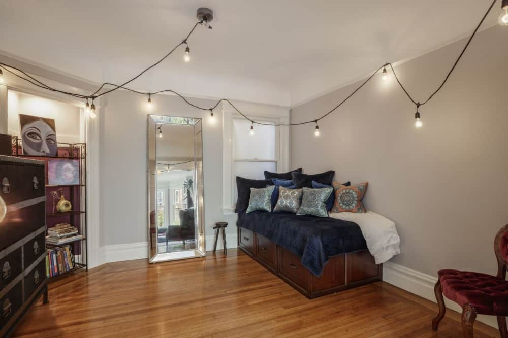 A spacious kid's bedroom with a stylish bed set and charming ceiling lights. Images courtesy of Toptenrealestatedeals.com.