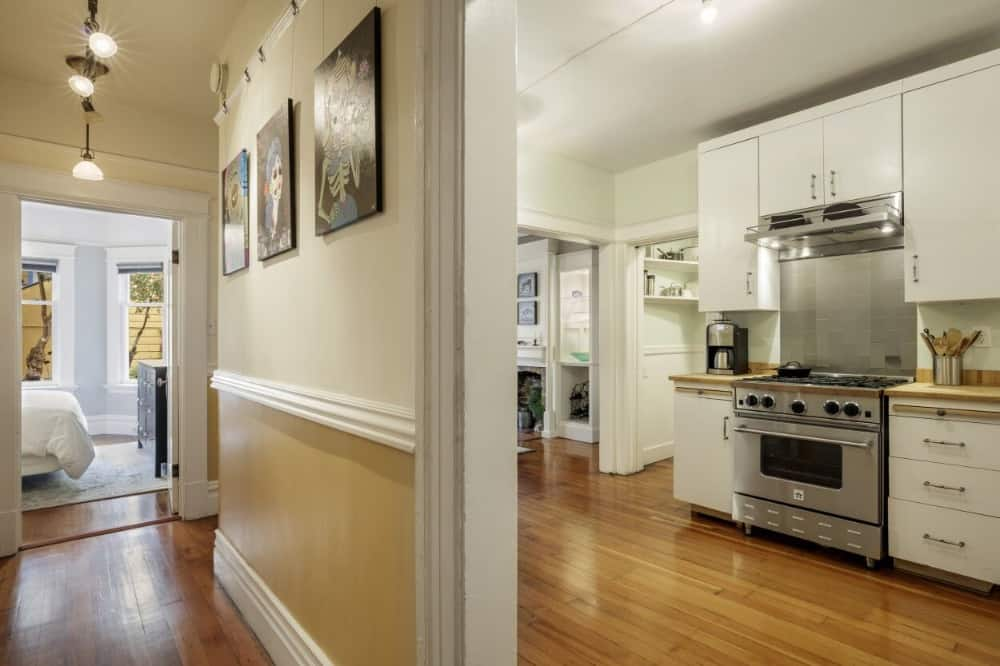 Here's the entry to the kitchen showcasing the beige and yellow walls along with the hardwood flooring. Images courtesy of Toptenrealestatedeals.com.
