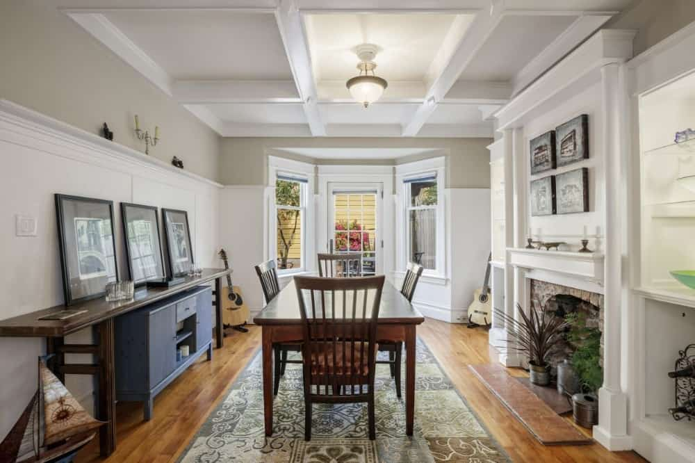 The formal dining room boasts a wooden dining table and chairs set along with a fireplace on the side. Images courtesy of Toptenrealestatedeals.com.