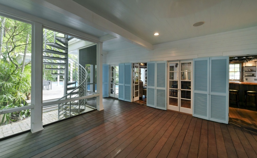 Here's a large hall with hardwood flooring leading to the house's dine-in kitchen and bar area. Images courtesy of Toptenrealestatedeals.com.