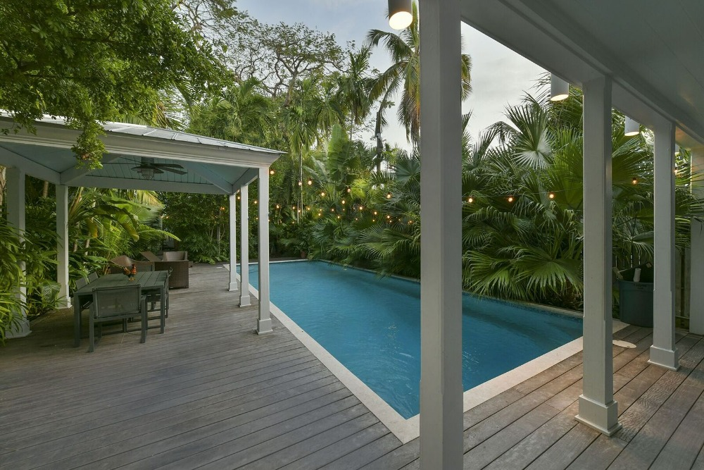 There's a swimming pool outside, surrounded by the home's greenery. Images courtesy of Toptenrealestatedeals.com.