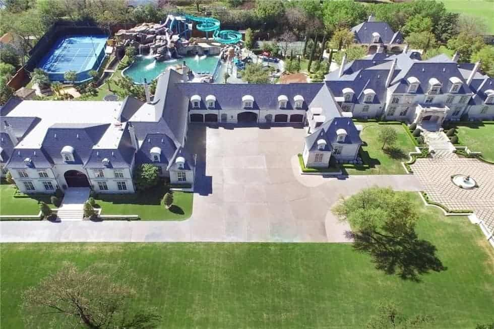 Aerial view of the $32 million Dallas mansion featuring its exterior and outdoor amenities.