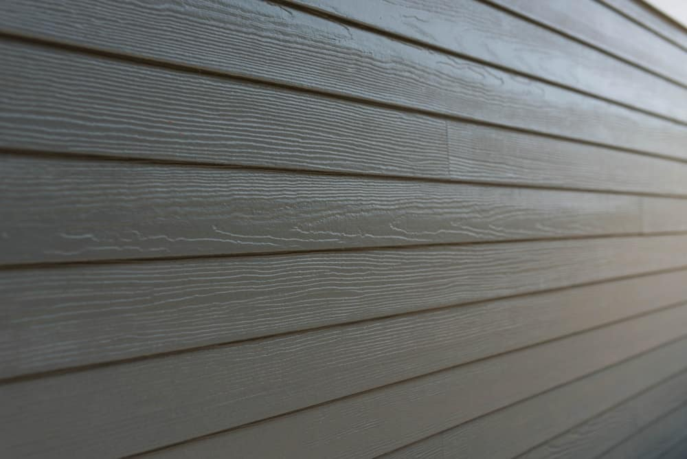 Close up of a dark gray vinyl siding.