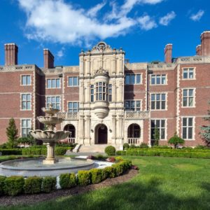This English Gothic Revival mansion named Darlington Mansion has red brick exterior walls complemented by multiple windows and the massive central stone structure of the house with arches at the main entrance. The house is beautifully foregrounded by the massive fountain at the front yard. Images courtesy of Toptenrealestatedeals.com.