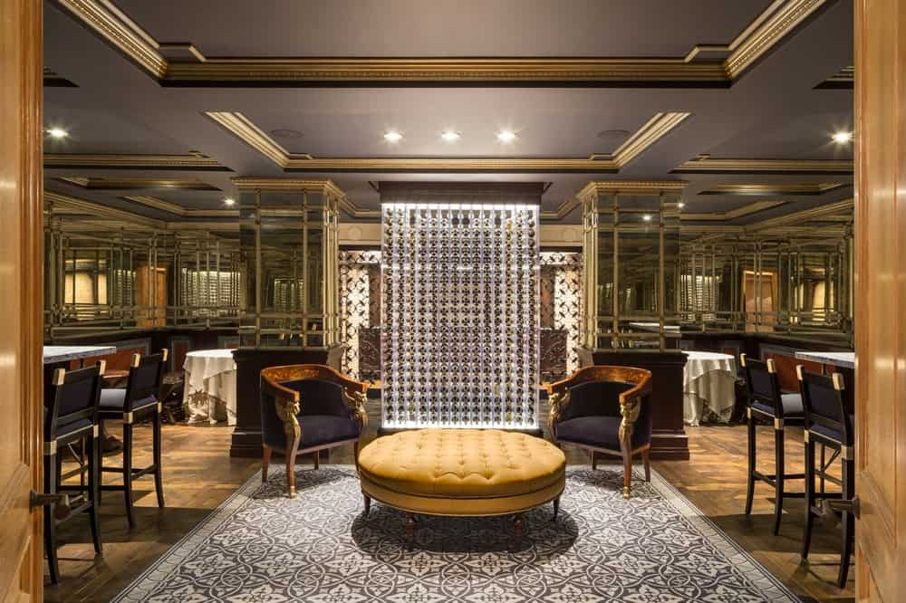 This is the lush and luxurious wine cellar that has its own large tasting area with a couple of bars. The area is festooned with mirrored walls and lovely coffered ceiling that sets a charming background for those sitting on the cushioned arm chairs paired with a circular cushioned coffee table. Images courtesy of Toptenrealestatedeals.com.