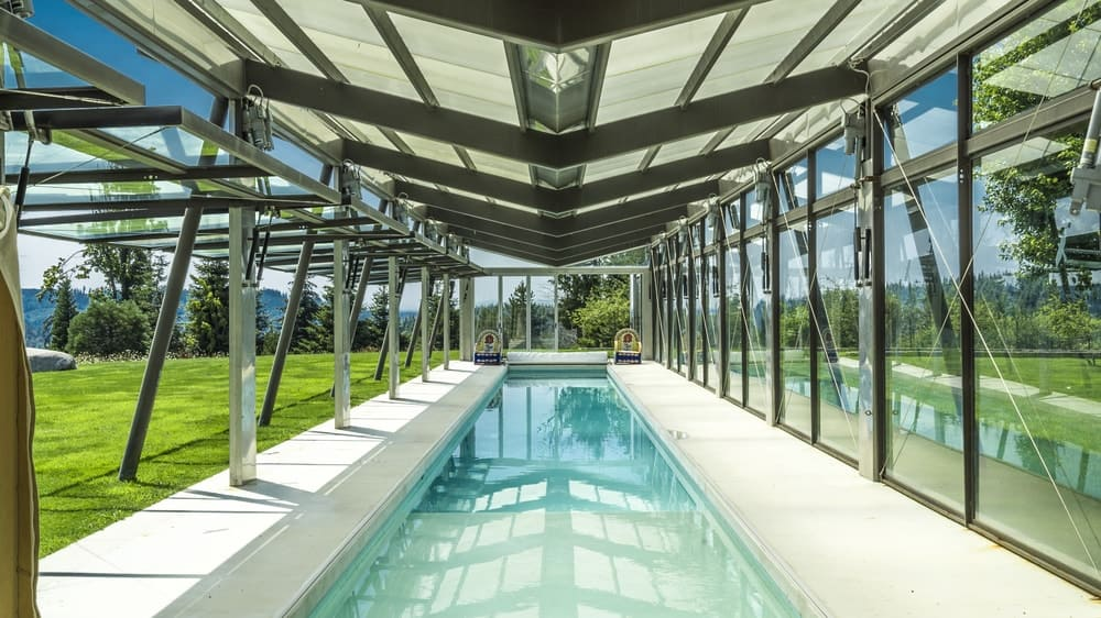 Just a few steps from the playground is this long covered pool surrounded by glass walls that can open to the lawn beyond. Images courtesy of Toptenrealestatedeals.com.