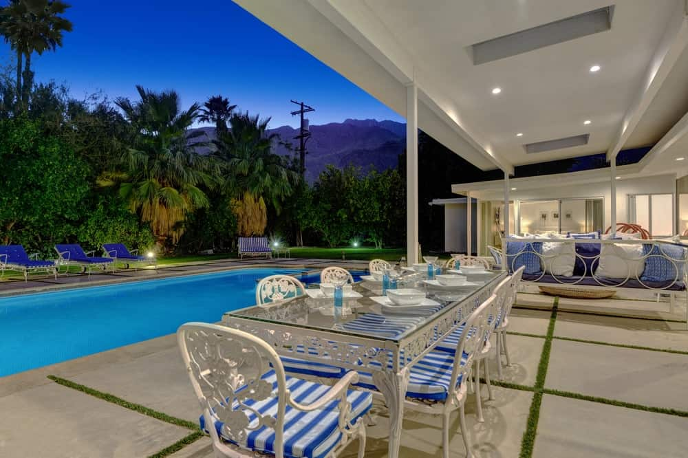 The outdoor dining area is just a few steps from the beautiful swimming pool that is surrounded by lush landscaping and outdoor lighting. Images courtesy of Toptenrealestatedeals.com.