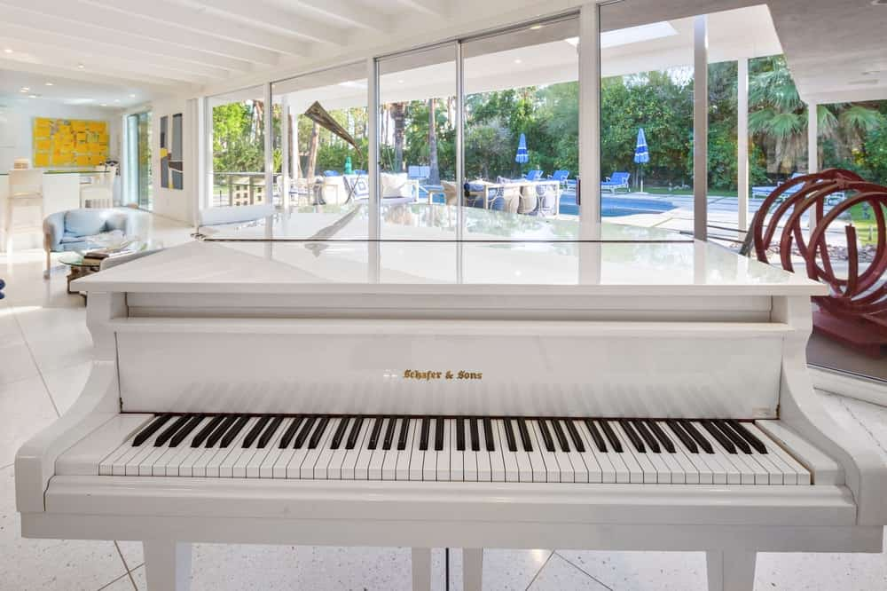 This is elegant white piano that made this house more famous with Barry Manilow writing one of his songs on it. Images courtesy of Toptenrealestatedeals.com.