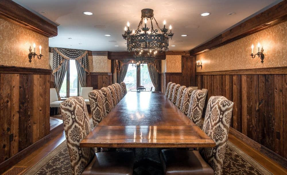 A formal dining room with a large dining table set paired with elegant chairs and is lighted by a glamorous chandelier. Images courtesy of Toptenrealestatedeals.com.