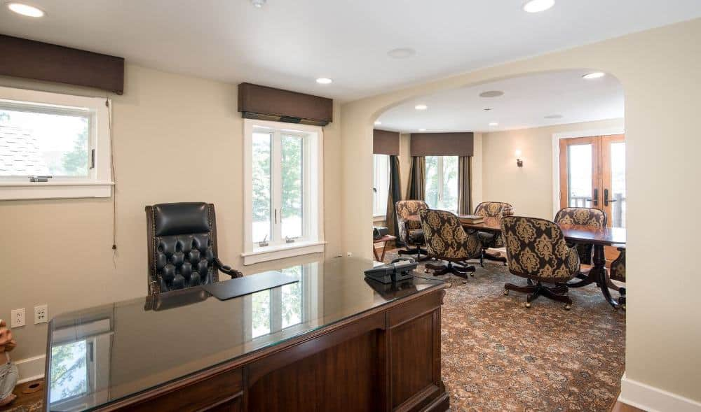 Here's a home office with a desk and chair set, along with a multi-use oval-shaped table paired with modern chairs on the side of the room. Images courtesy of Toptenrealestatedeals.com.