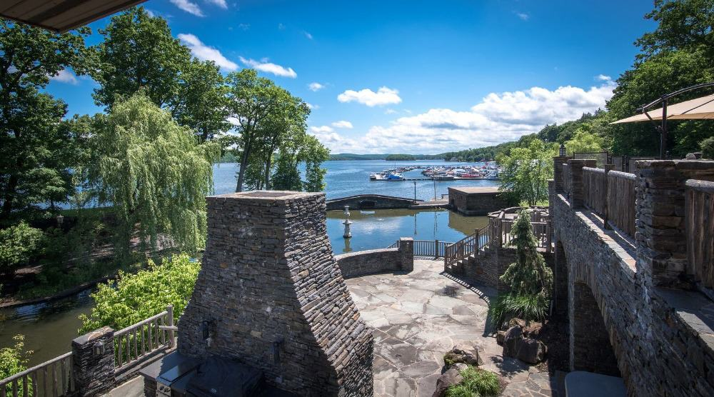 A view of the lake from the home's patio and outdoor dining area. Images courtesy of Toptenrealestatedeals.com.