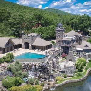 Aerial view of the property boasting the castle's gorgeous exterior and its many exciting outdoor amenities. Images courtesy of Toptenrealestatedeals.com.