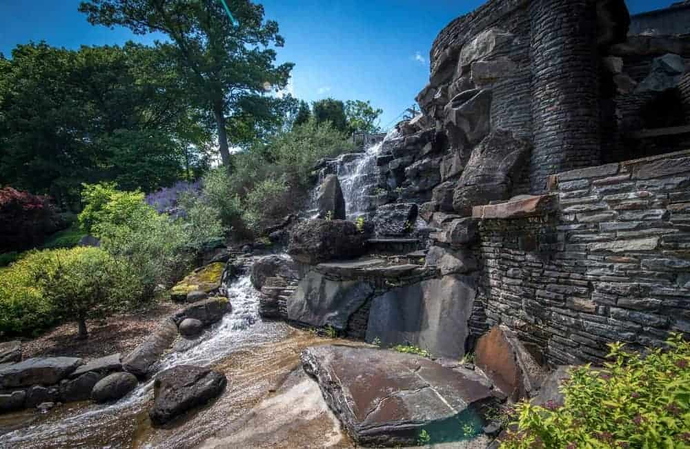Here's a waterfall landscaping design that is just very attractive. Images courtesy of Toptenrealestatedeals.com.