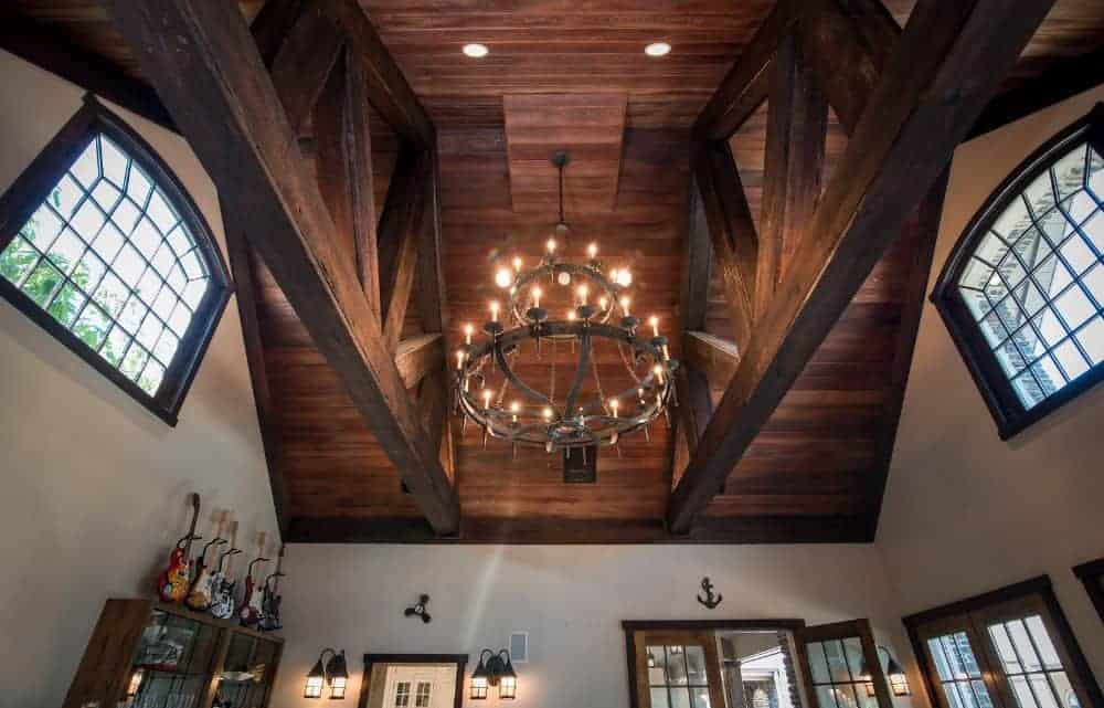 A look at this area's high wooden ceiling lighted by a glamorous chandelier. Images courtesy of Toptenrealestatedeals.com.