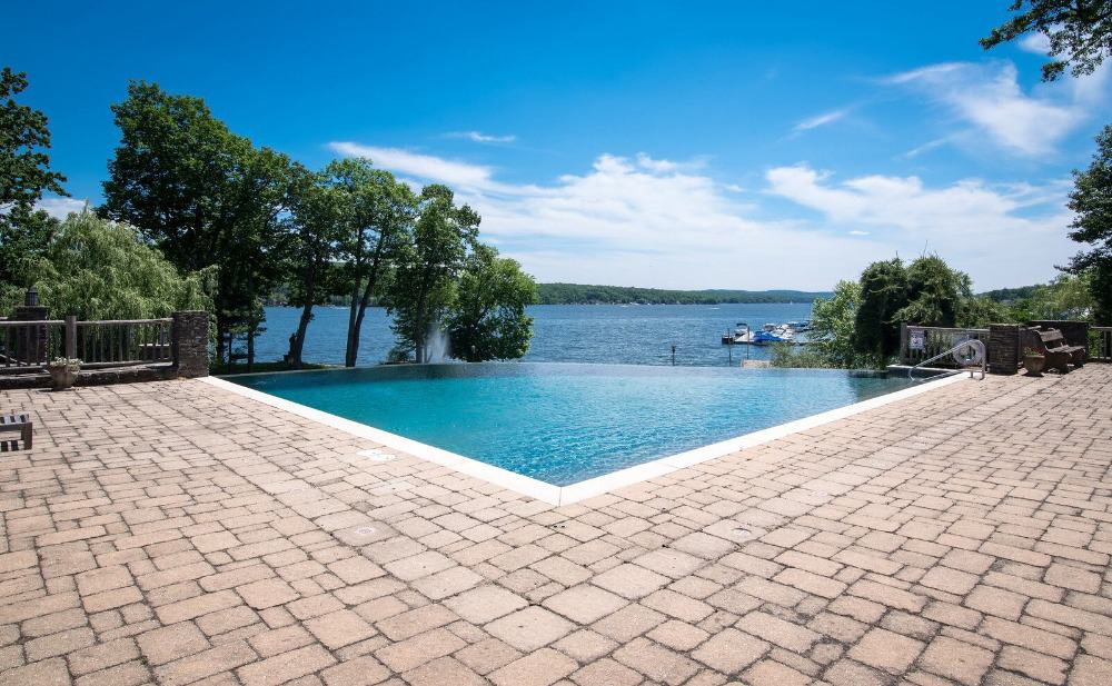 A closer look at the home's custom infinity swimming pool with a nice view of the lake. Images courtesy of Toptenrealestatedeals.com.