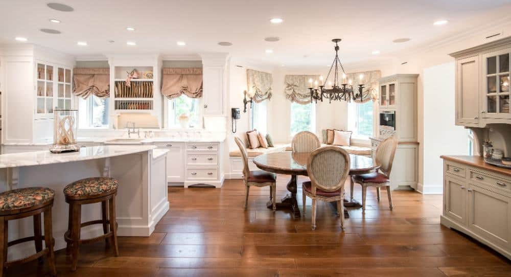This dine-in kitchen offers a charming dining nook lighted by a gorgeous chandelier along with a breakfast bar. Images courtesy of Toptenrealestatedeals.com.