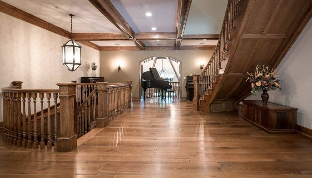 The home's hall boasts hardwood floors, wooden railings and gorgeous staircase. Images courtesy of Toptenrealestatedeals.com.