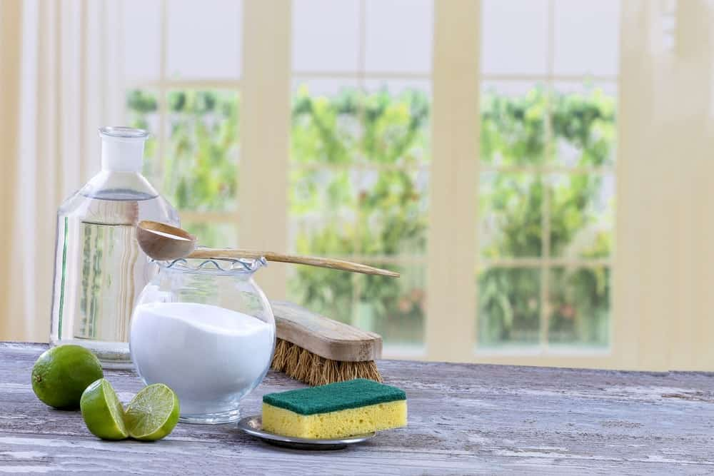 Ingredients for home-made cleaners like baking soda, vinegar and lime.